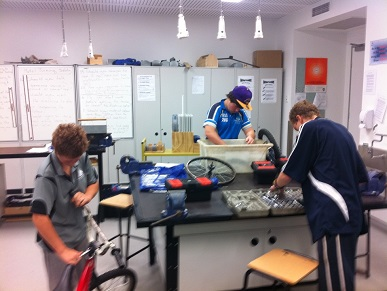 Students developing their mechanical skills in the choppers program