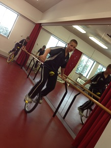 Students successfully learning how to ride a unicycle