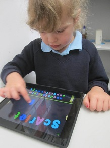 Preschool student using and iPad